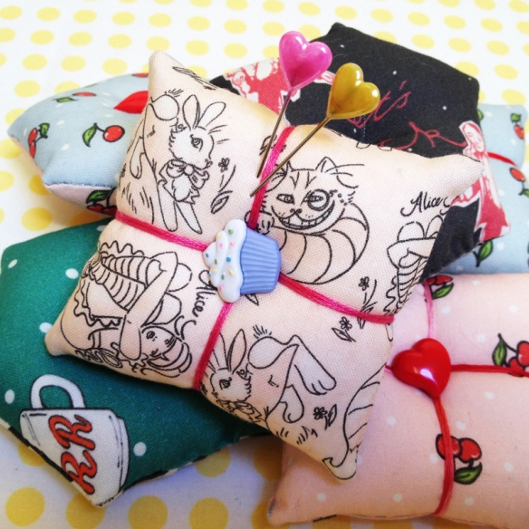 cherry and cinnamon custom fabric pincushions